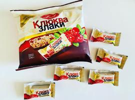 Конфеты на подложке из  шоколадной  глазури. 240 гр. Клюква и злаки